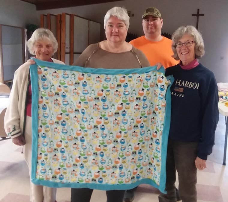 Tully parishioners make quilts for those in need