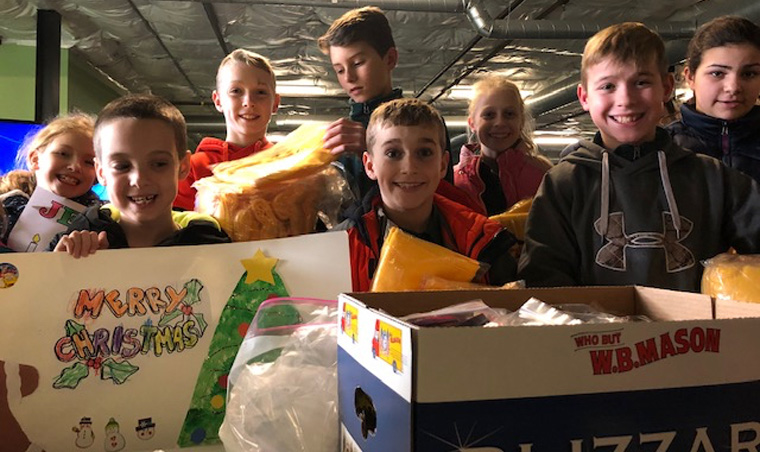 Holy Family School group spreads cheer at shelter in Syracuse