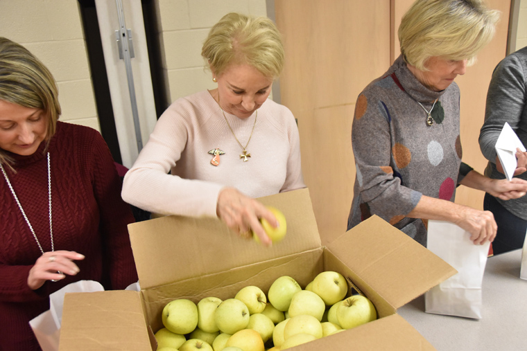 Jolly volunteers fill goody bags and visit inmates