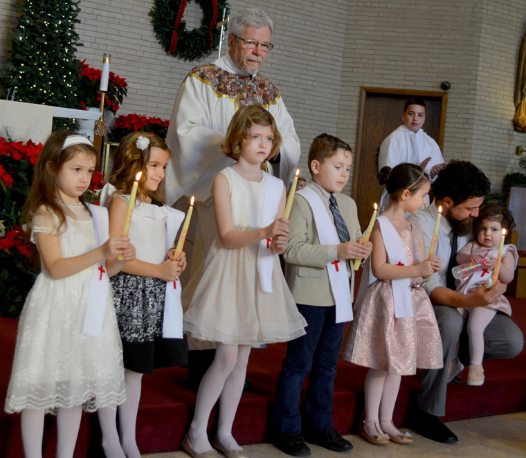 Ceremony marks six baptisms, one First Holy Communion  at Our Lady of Lourdes Church in Utica