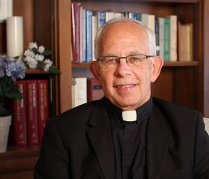 Father John Rose 1 1 - Monsignor holds the key to moving past the grudges