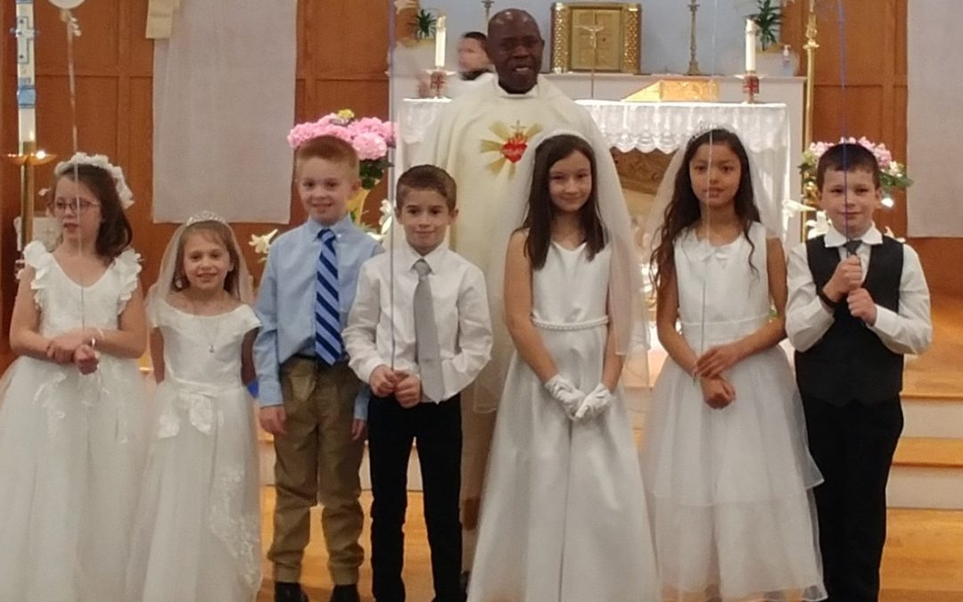 Seven children receive First Holy Communion at church in Greene