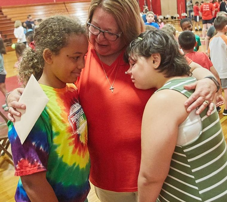 Up, up, and away again: Principal for 32 years retires
