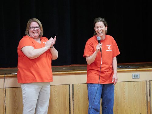 Andrea laughs with Lisa color - Up, up, and away again: Principal for 32 years retires