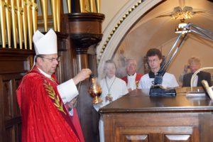 bishop blesses console 300x200 - bishop blesses console