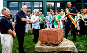 15 Holy water in hand Father Richard Dellos prepares to bless Uticas Irish Center Vaughn Lang left Father Jim Salero and AOH President Russ Brooks look on 7 19 2019 5 31 11 PM 4589x2794 1 copy 300x183 -