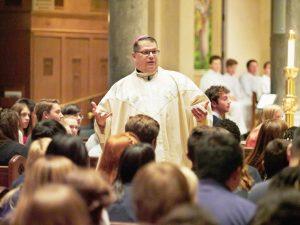 Bishop talks among students 300x225 - OLYMPUS DIGITAL CAMERA