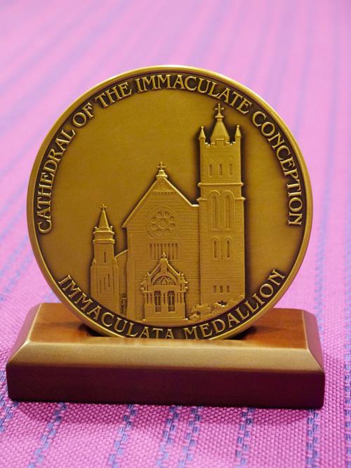 Immaculate medallion - 'A good balance of Faith and Action'