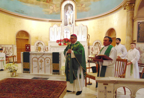 BISHOP 12 - Bishop celebrates with Mount Carmel/Blessed Sacrament parishioners