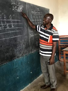 Emmanuel Maneno head of SOHUCO teaches women how to spell and sound Dales name color 225x300 - Emmanuel Maneno head of SOHUCO teaches women how to spell and sound Dale's name color