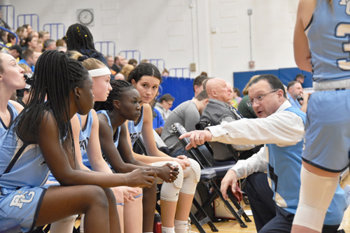 Grimes Coach John instructs - Hoop heroes abound