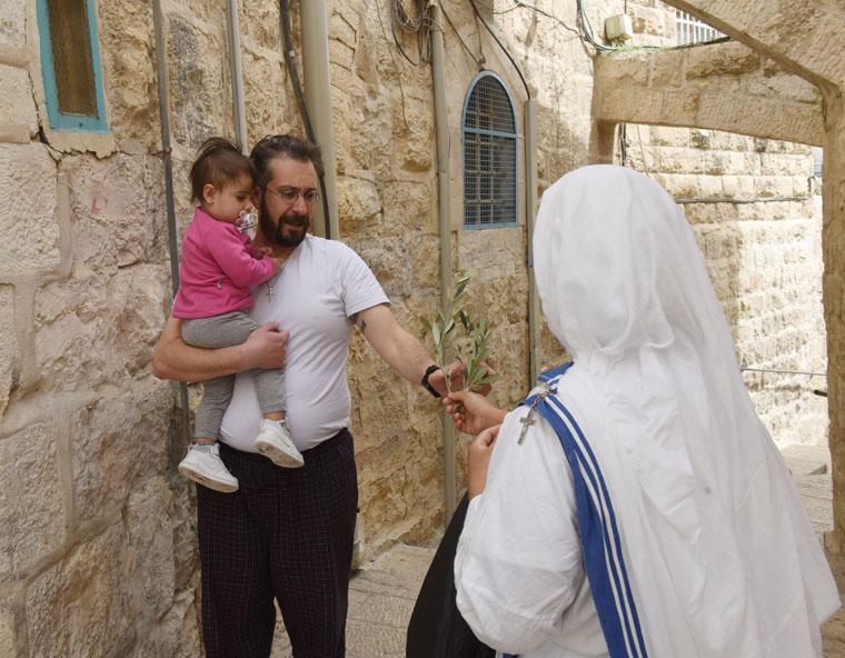 Surgical masks, social distancing: Palm Sunday in Jerusalem's Old City