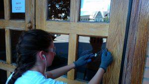 Emily works on door 300x169 - Emily works on door