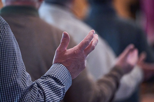 hands up in prayer - IGNITE Catholic Men's Conference 'super-pumped' for faith