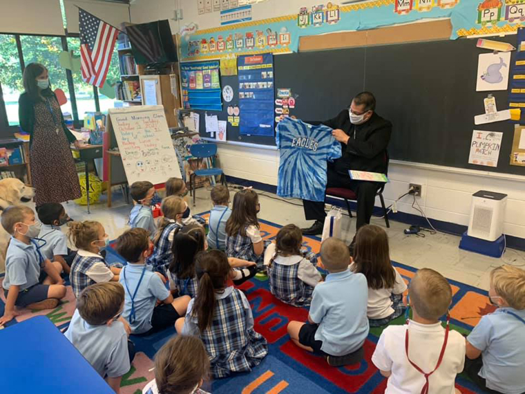 Bishop Lucia reads to kindergartners at IC School in Fayetteville