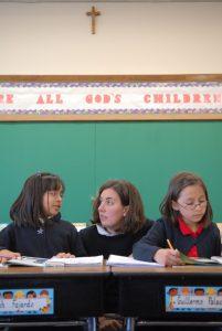 cover 201x300 - VOLUNTEER HELPS STUDENTS IN CLASSROOM OF MILWAUKEE SCHOOL