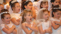 first 120x67 - GIRLS SING DURING FIRST COMMUNION SERVICE