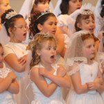 first 150x150 1 - GIRLS SING DURING FIRST COMMUNION SERVICE