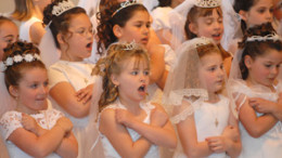 first 260x146 - GIRLS SING DURING FIRST COMMUNION SERVICE