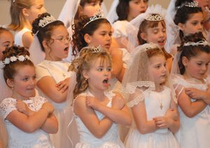 first 300x212 - GIRLS SING DURING FIRST COMMUNION SERVICE