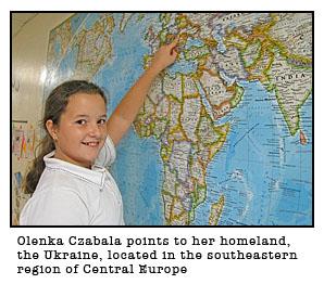 stjames olenka - 001.jpgOLENKA CZABALA POINTS TO HER HOMELAND( Photo submitted )